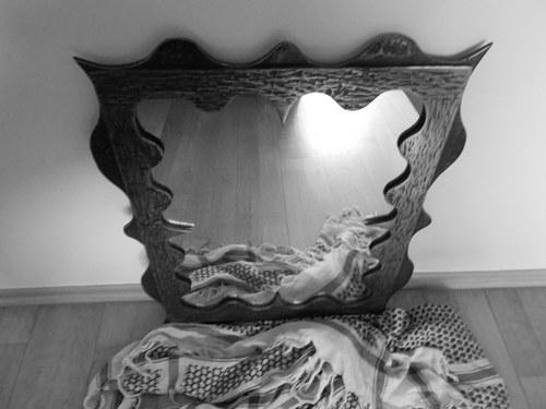 Zrcadlo v kovaném rámu