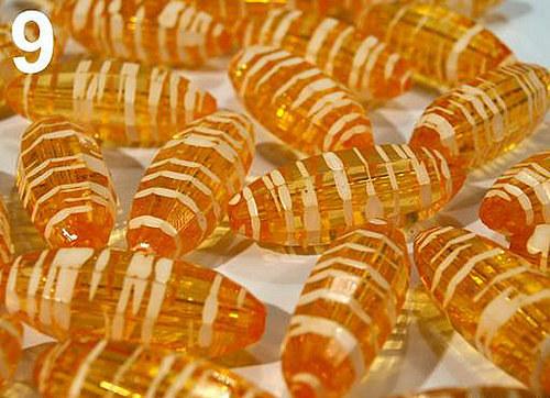 Korálky průhled. PROUŽEK plast ovál 15x35mm oranž