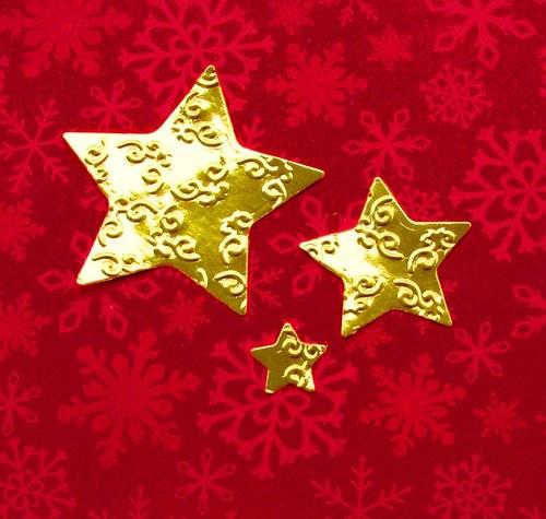 Tři embosované hvězdy metalické