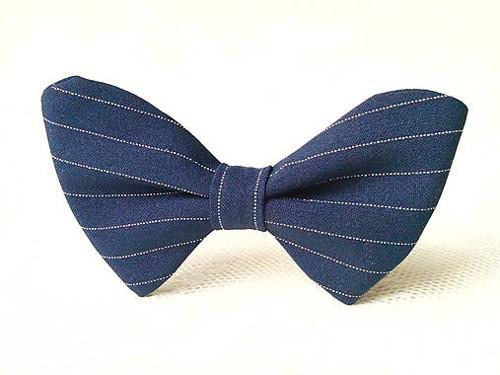 Dark blue bow tie with white stripes