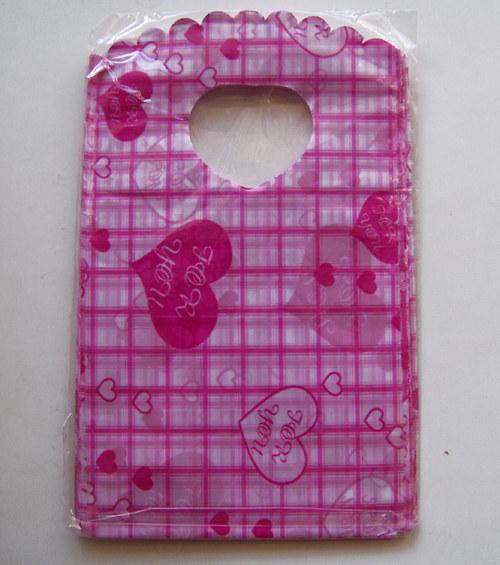Taška mikrotenová 60mic/ srdce pink2/9x15cm/ 50ks