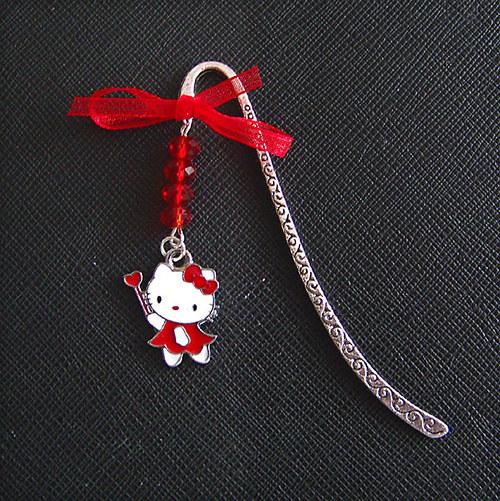 SLEVA Záložka do knihy kočka Kitty červená