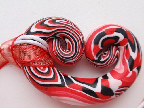 Červený kaleidoskop preclík