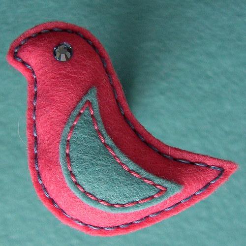 Růžový ptáček Aivo