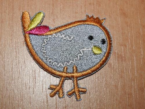 Nažehlovačka reflexní ptáček