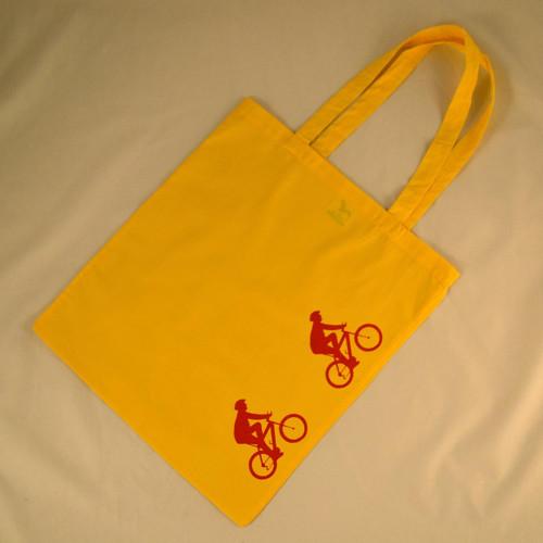 Žlutá taška s červenými cyklisty