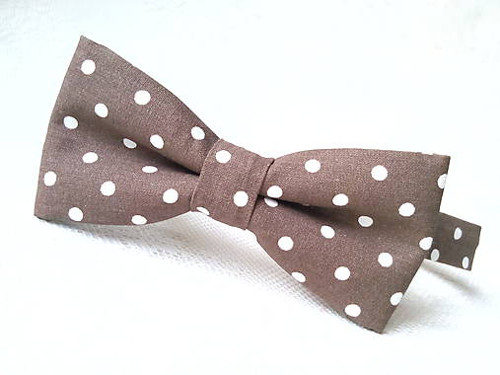Brown bow tie with white polka dots