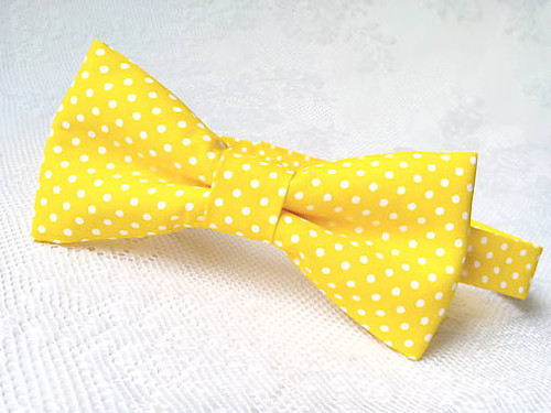Yellow bow tie with small white polka dots