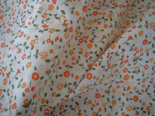 látka - metráž - oranžové kytičky