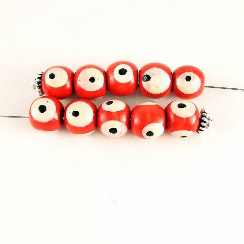 Dřevěné korálky  s okem červené 4 ks