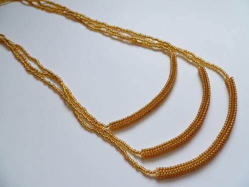 Zlatý náhrdelník se třemi řadami