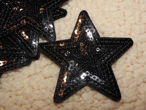 Nažehlovačka hvězda černá