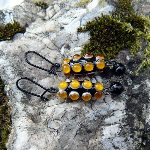 Náušnice okaté olivy - hnědé (topas tmavý)