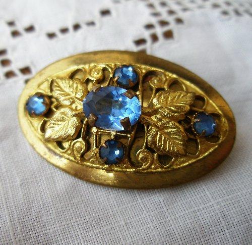 Zlacená  brož s modrými kameny