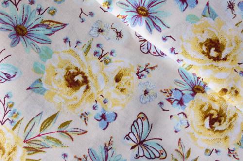 Žluté a modré květy na bílé 100% bavlně