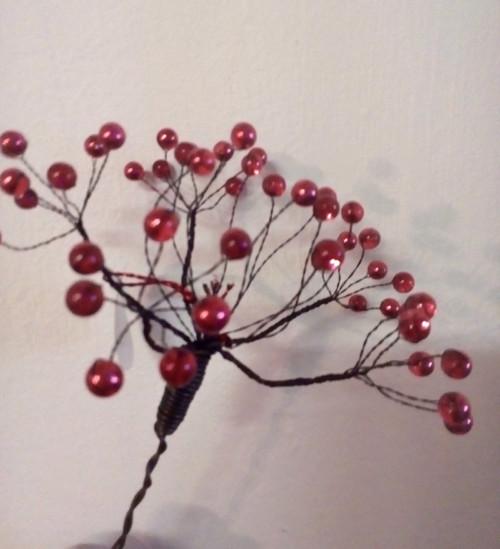 Kytka červená -kopr