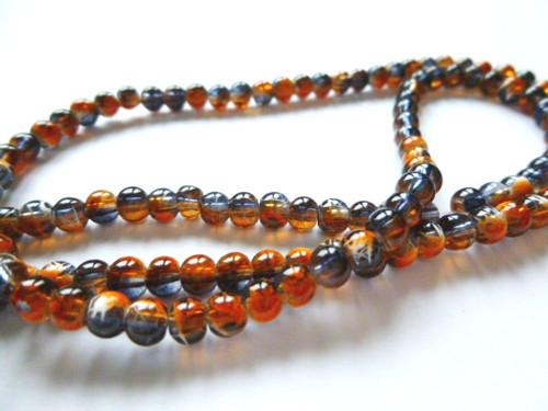 Černé korálky s oranžovým dekorem 4mm/20ks