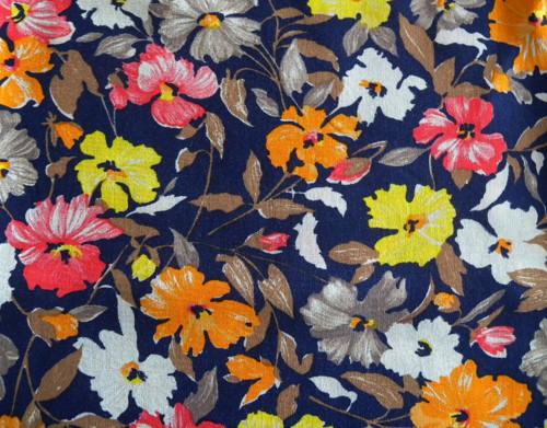 Květovaná šatovka modro-žluto-oranž-zbyt.140x15cm