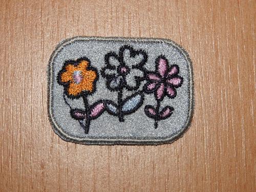 Nažehlovačka reflexní květiny