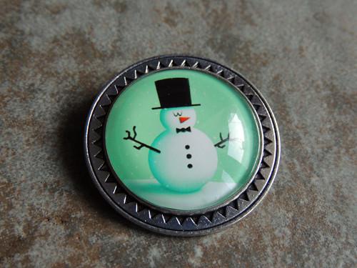 Sněhulák s cylindrem, brož