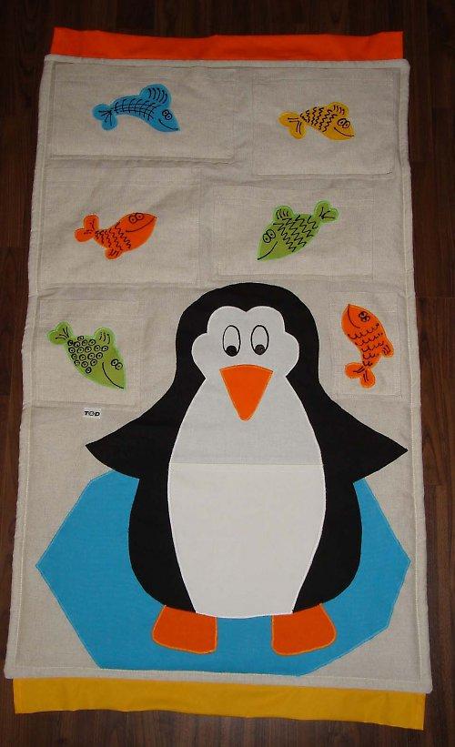 Rozdováděné rybky....a tučňák