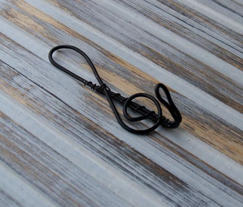 Věšáček- houslový klíč