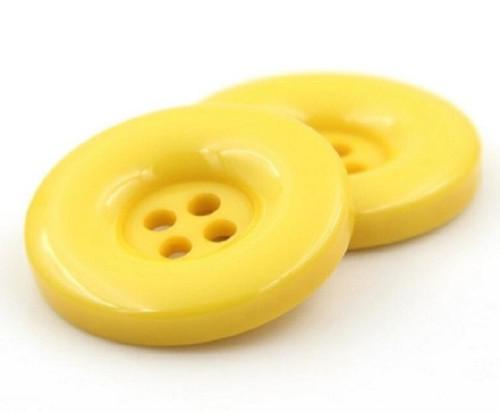 Plastový knoflík 15 mm 2 kusy žlutý