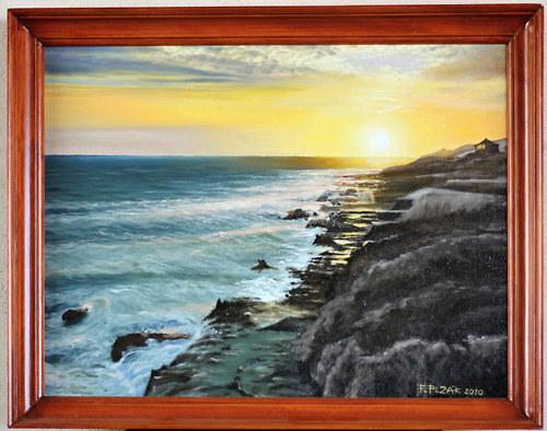 Západ slunce na mořském pobřeží