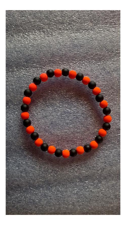 náramek: černá a neonově oranžová