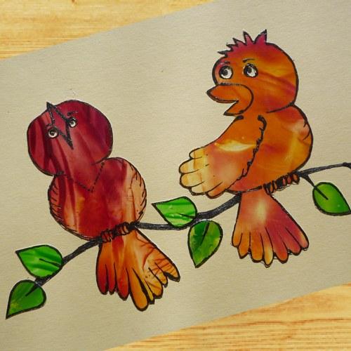 Červení zpěvní ptáci