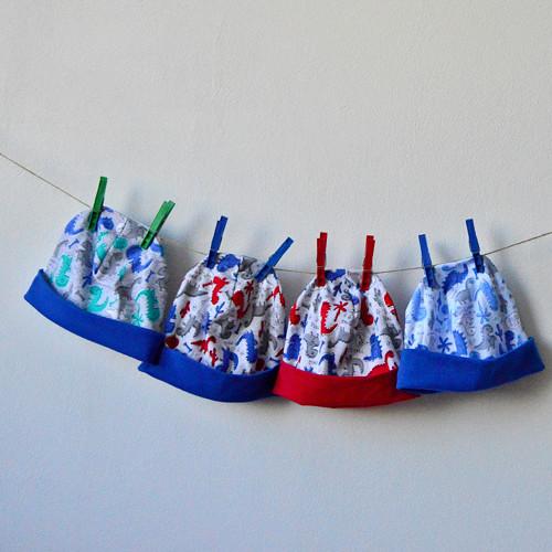 dětská veselá čepice - různé druhy - dinosauři
