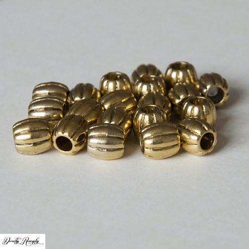 zlaté oválky tibetského typu - dírka 3.8mm - 20 ks