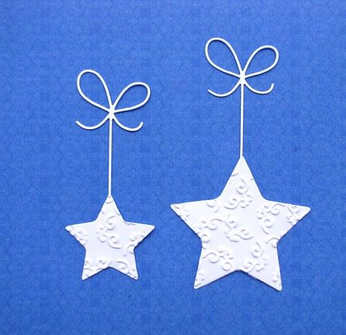 Dvě embosované hvězdy na stužkách
