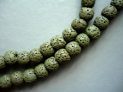 Vrtaný korálek - láva 9 mm, 2 ks