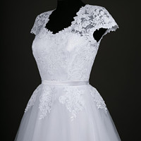 fbdf8fbb0d08 Svatební šaty s tylovou kruhovou sukní · Dyona · O+. 582.39 €. Spoločenské  šaty z hrubej krajky SKLADOM veľ. 38 -